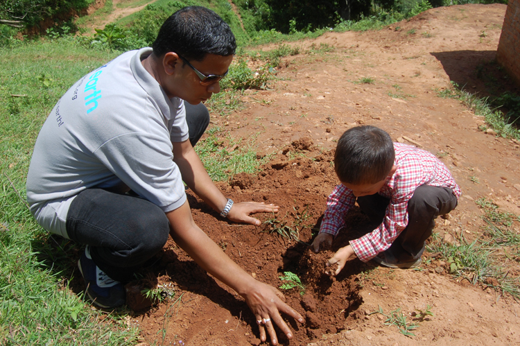 4_PEN member and student jointly planting a tree at Shree Kalika Primary School