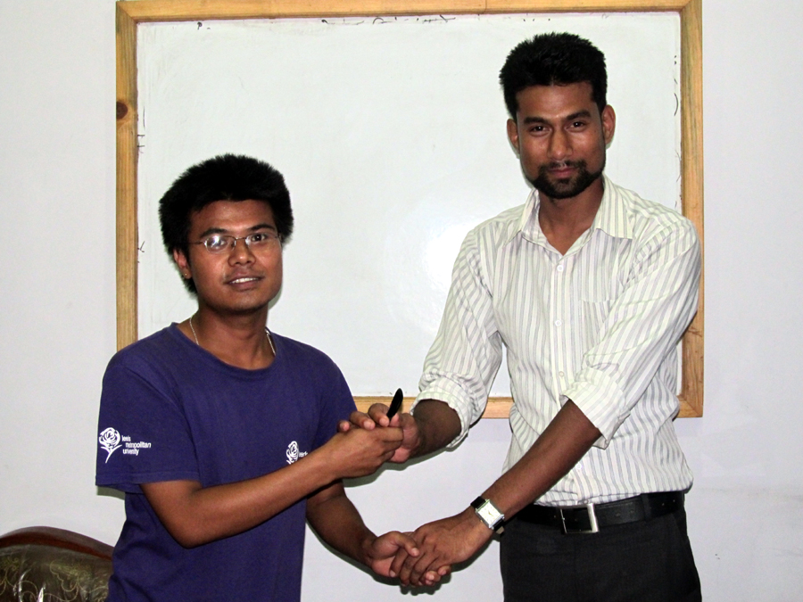 8_Best table topics speaker Laxman Pahari receiving the award from TMD Shreebatsa
