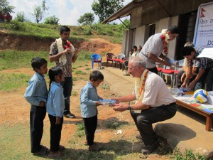 2_A student of Shree Kalika School receiving the stationery from a British friend