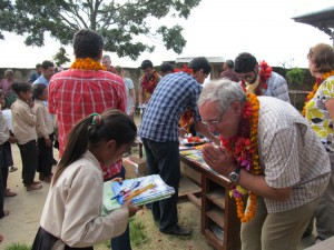 5_A student of Shree Raktakali School receiving the stationery from a British friend