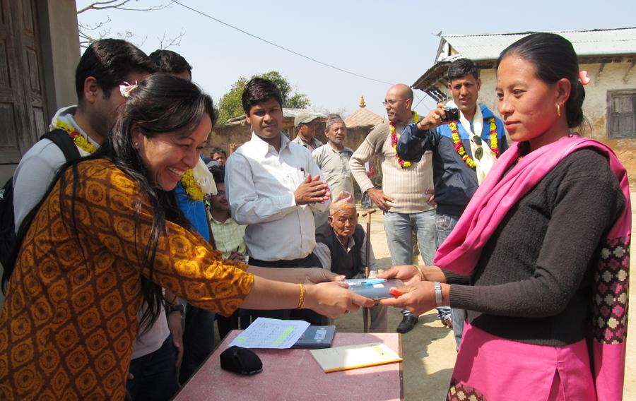 5_Board Member Kamala Basnet handing stationery to a teacher of Shree Raktakali Primary School