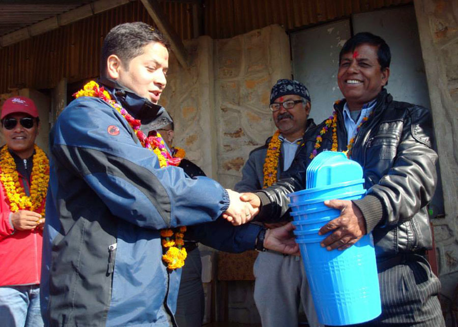 4_President Sujan Koirala handing over dustbins and dustpans to the Principal of Seti Devi School