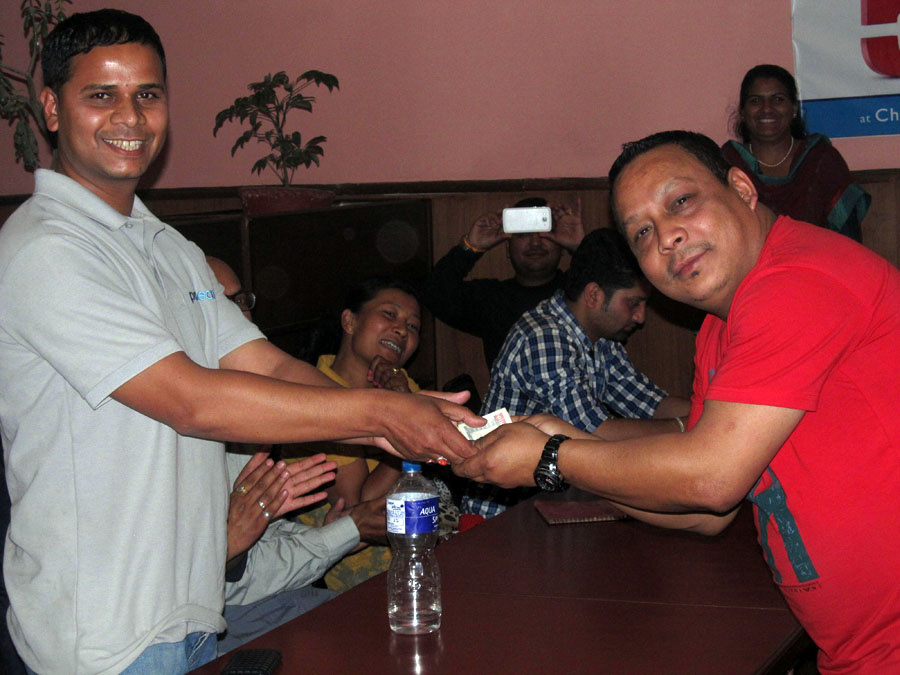5_Member Debraj Ghimire Handing over amount saved by giving up chewing gum to Treasurer Bal Gopal Shrestha
