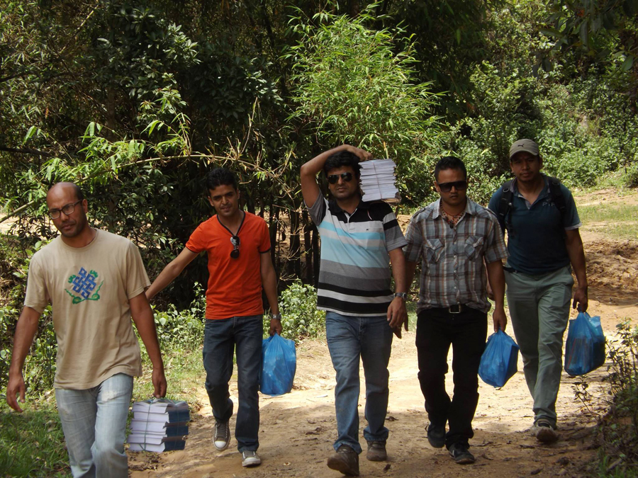 1_Pax Earth members carrying educational materials to Shree Seti Devi School