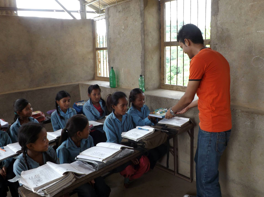 2_Pax Earth team member distributing educational materials to the students of Shree Seti Devi Primary School