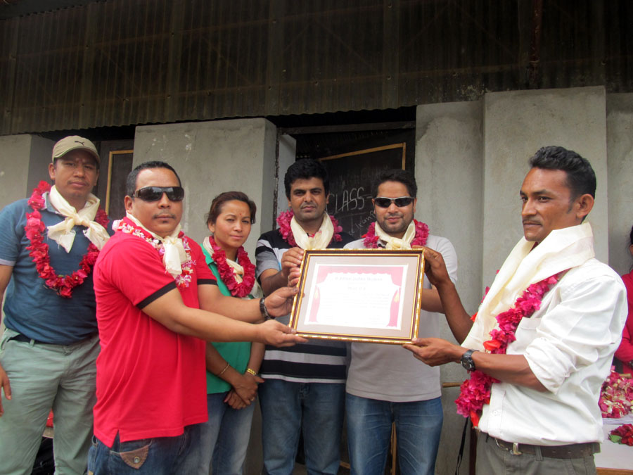 7_Chairman of School Management Committee handing over a letter of appreciation to President Sujan Koirala and Board Members