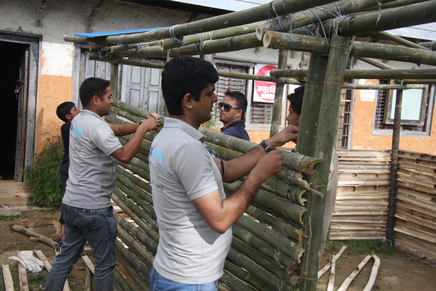 7_Pax Earth members making bamboo wall at Raktakali school