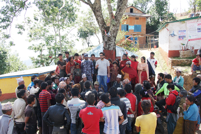 President Sujan Koirala addressing the earthquake victims before distribution of tarpaulin tents.