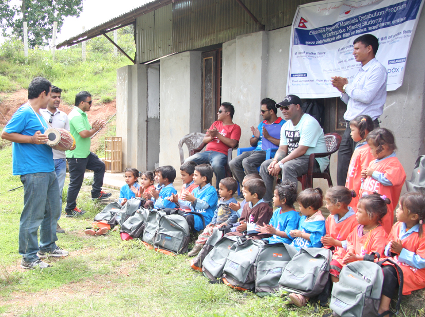 Earthquake survivor students enjoying music after receiving the educational materials from Pax Earth July 23