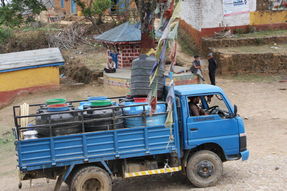 Drinking water being transported in plastic tanks by a vehicle to Kot Timal village