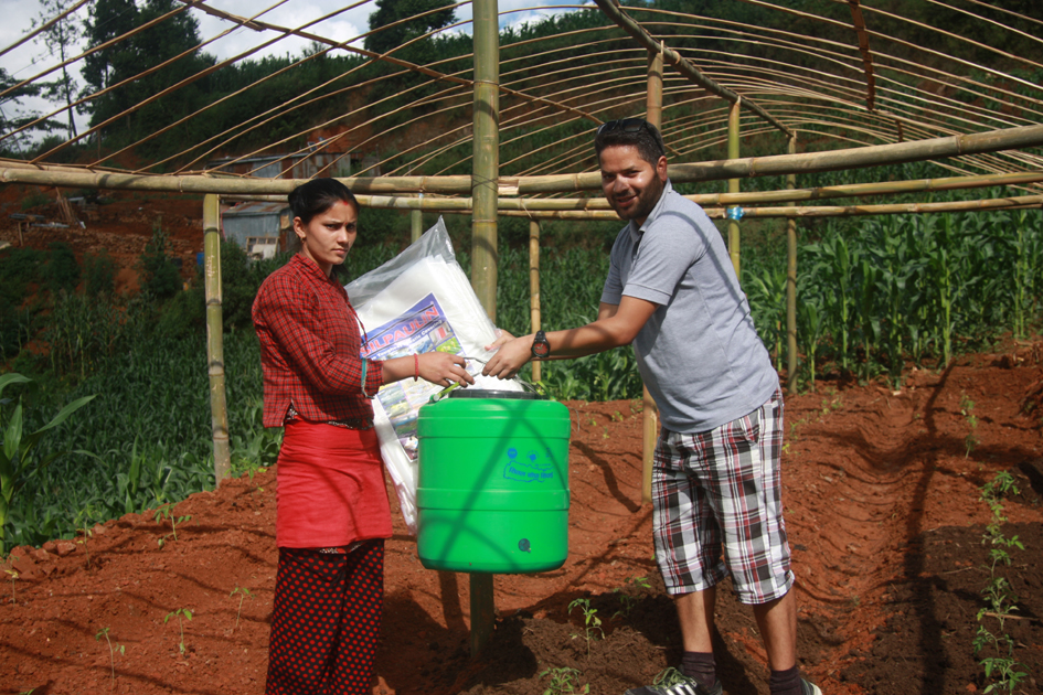 Pax Earth President Sujan Koirala distributing a drip irrigation kit and a Silpaulin sheet to a farmer in Kot Timal vilalge.
