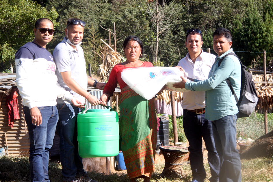 Pax Earth president Sujan Koirala, technical expert Rajan Gaire and other members distributing a drip irrigation kits and silpaulin to a farmer in Kot Timal
